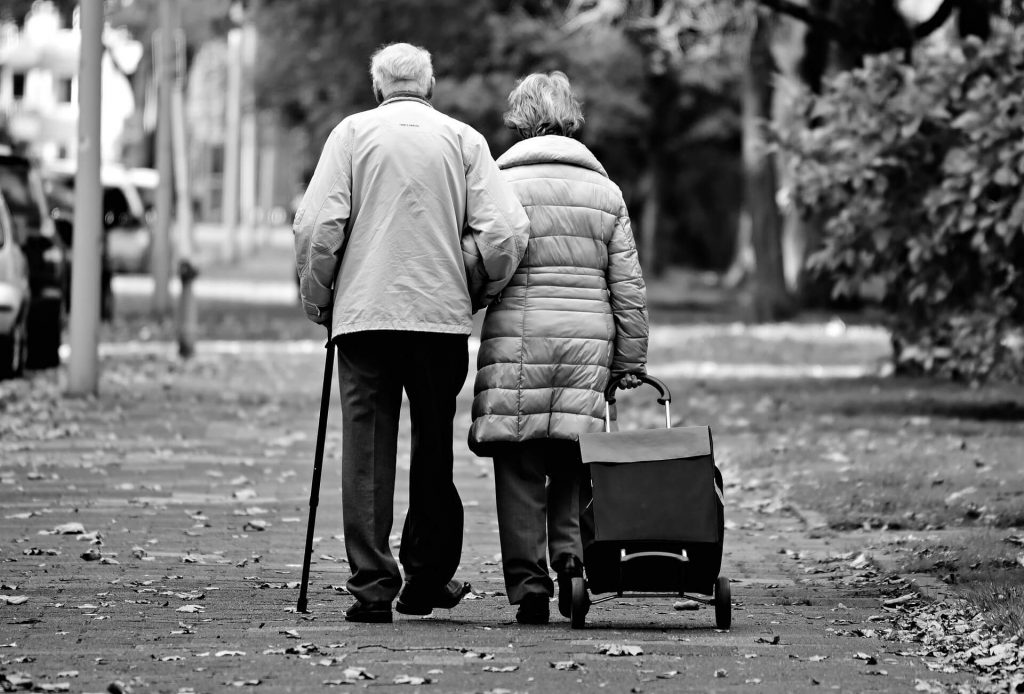 older couple walking hand in hand