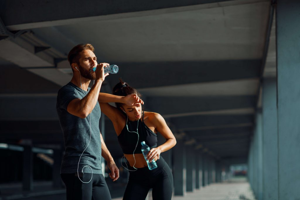 Couple learning how to protect their joints with exercise and recovery