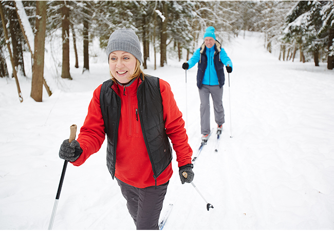 two women cross country skiing